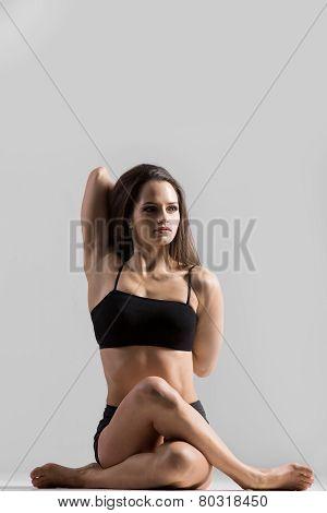 Athletic Yogi Girl In Sportswear Practices Yoga Asana, Gomukhasana