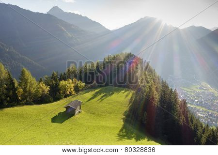 Hut in sunlight with a view to Mayrhofen