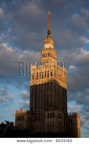 The Palace of Culture and Science in Warsaw Poland was donated by Stalin in 1955. Picture taken as the sun is setting. poster