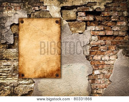 The Old Paper Attached To The Cracked Wall