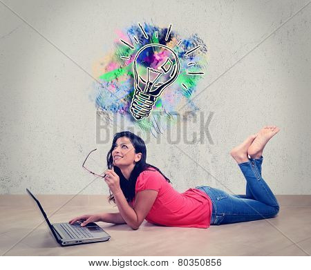 Young Woman Smiling In Front Of Laptop