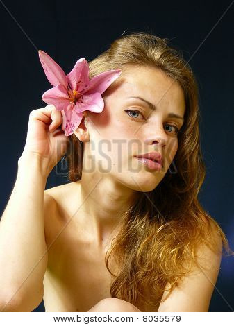 Woman With A Lily  In Hairs
