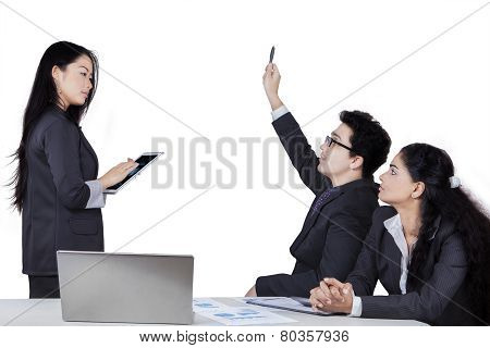 Businessman Asking To The Meeting Leader