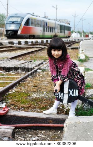 Little girl on a train station