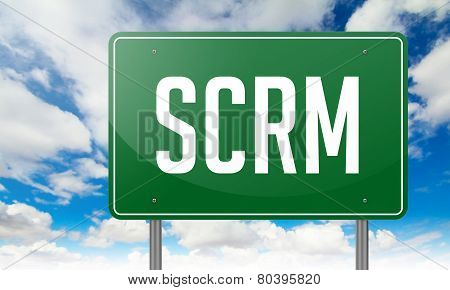 SCRM on Green Highway Signpost.