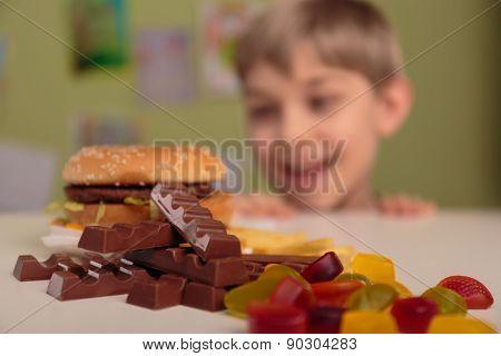 Boy Enjoying His Unhealthy Lunch