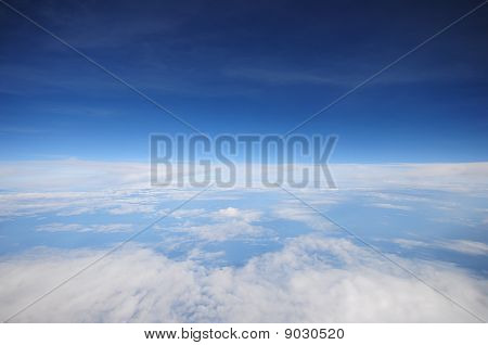 white fluffy clouds in the blue sky background
