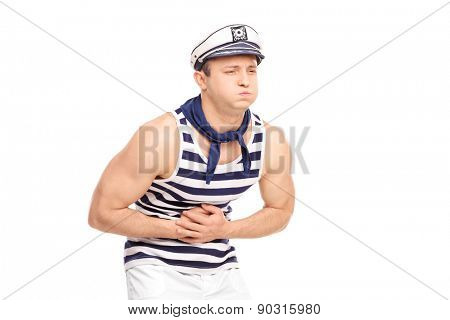 Young male sailor feeling stomach ache isolated on white background