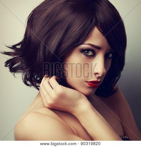 Beautiful makeup model with short black haircut and vamp look. Closeup art vintage portrait poster
