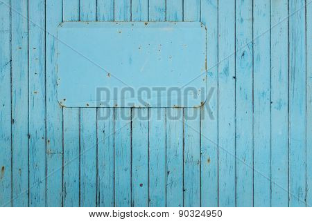 Blue sign on blue painted timber board background