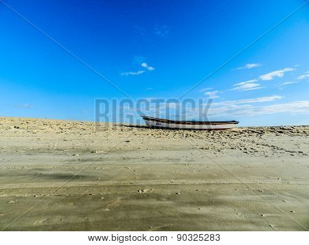 Boat stuck on sand in the low tide