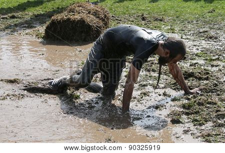 Man Fighting To Get Through The Mud On His Knees
