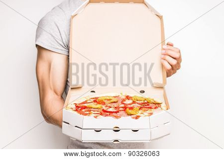 Young Man Holds Boxes With Pizza.