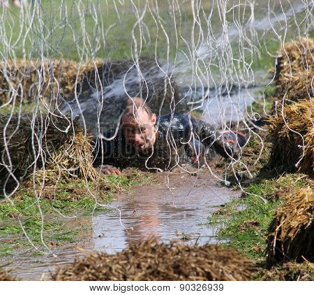 A Terrified Man Crawling In The Mud