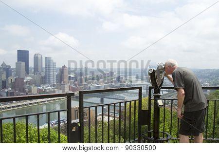 Tourist Looking Through Viewfinder