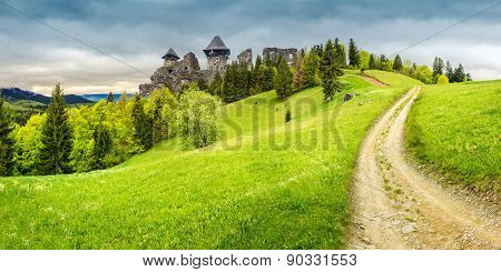 Path To Fortress Ruins On Hillside With Forest