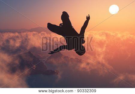 Parashutist against the blue sky.
