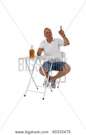 Brazilian man at a bar drinking cachaca and calling the waiter isolated on white background
