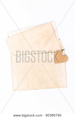 isolated old yellow envelope with paper hearts