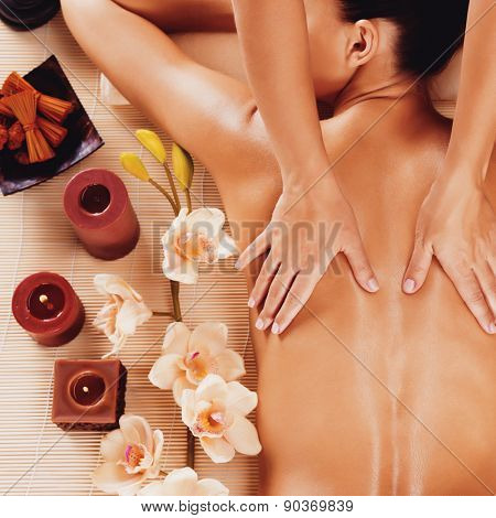 Masseur doing massage on woman back in the spa salon