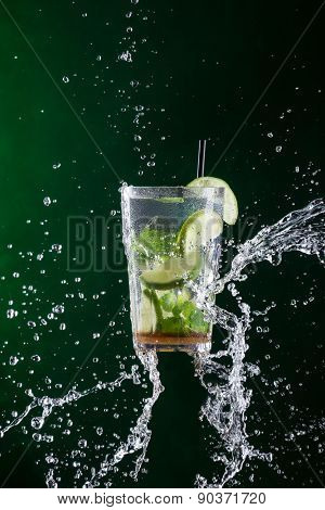 fresh mojito drink with liquid splash, freeze motion. poster