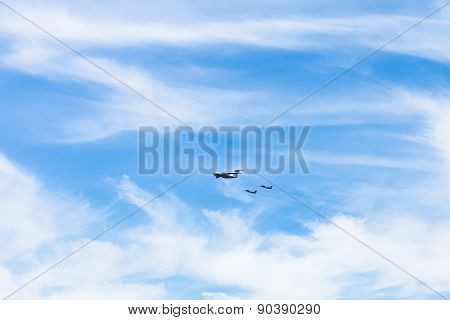 Air Refueling Of Fighter Airplanes In White Clouds