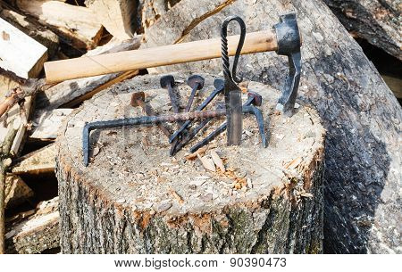 Hew Ax And Forged Hardware On Wooden Deck