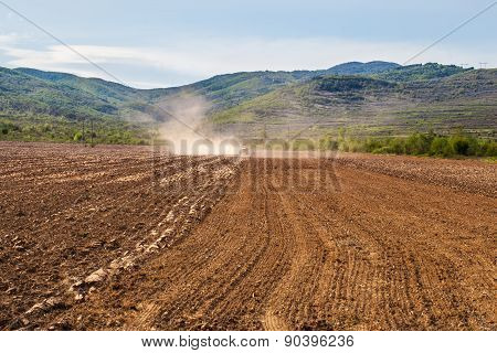 Plowing Tractor On Agricultural Field