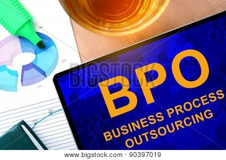 Words  Business Process Outsourcing BPO on the tablet and charts.