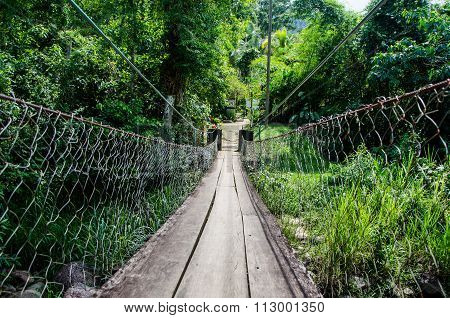 wooden bridge over the river path crossing danger courage daring radical adventure