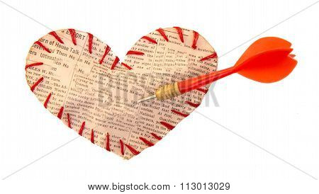 The Self-made Heart Sewed By Red Threads From A Newspaper Slice With The Dart Thrust In It.
