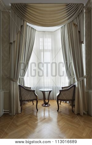 armchairs by the window