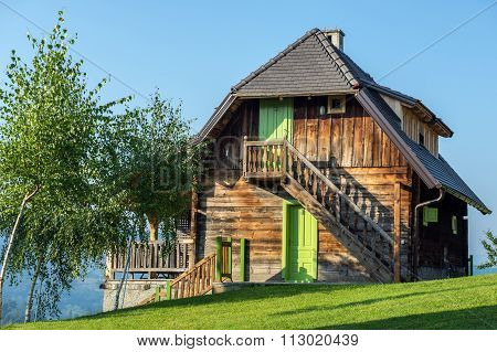 Wooden cottage house in traditional Drvengrad village Serbia poster
