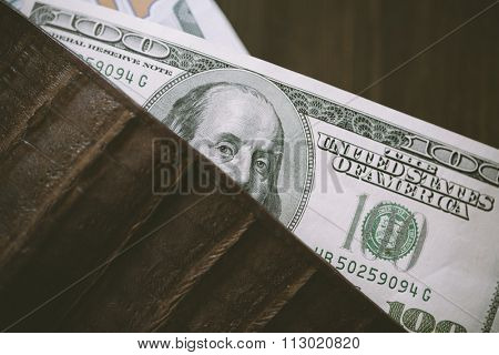 Cash and leather wallet in closeup