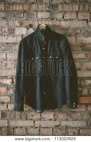 denim shirt on the brick background