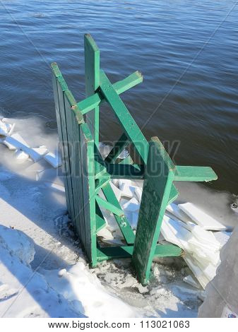 Green Picnic Table Frozen in the Winter Lakeshore