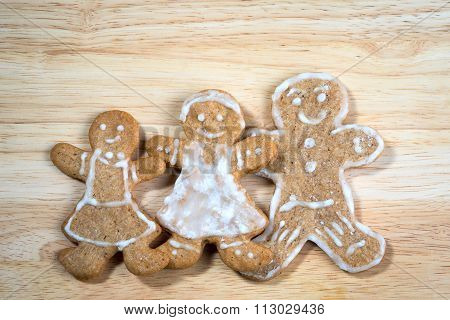 Christmas Homemade Gingerbread Cookies On Wooden Table - Happy Family Concept For Your Postcard