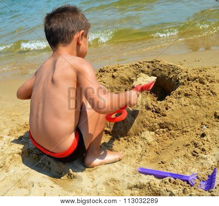 Kid On The Beach