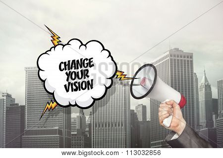 Change your vision text on speech bubble and businessman hand holding megaphone