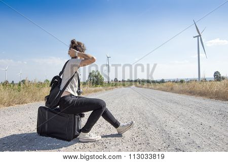 Young Girl Traveling With Bag Waiting For Bus