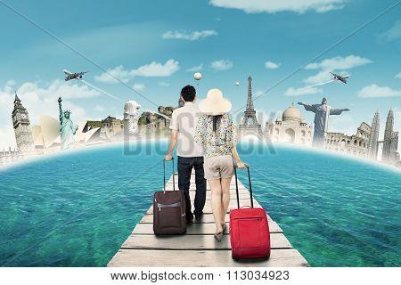 Couple Carrying Luggage On The Bridge