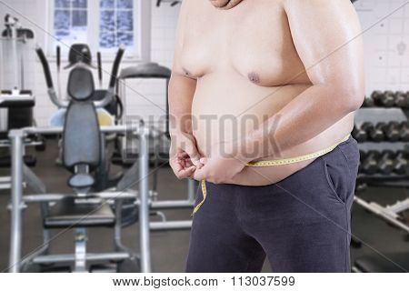 Fat Man Measuring His Stomach