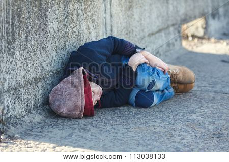 Young Homeless Boy Sleeping On The Bridge