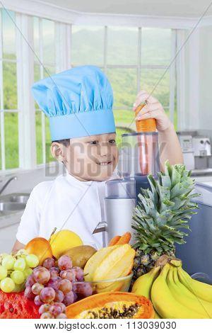 Little Boy Making Fresh Juice