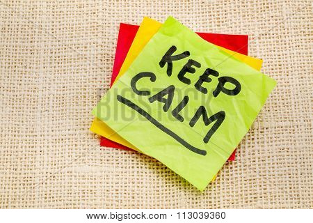 Keep calm reminder or advice on a sticky note against burlap canvas