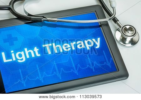 Tablet With The Diagnosis Light Therapy On The Display
