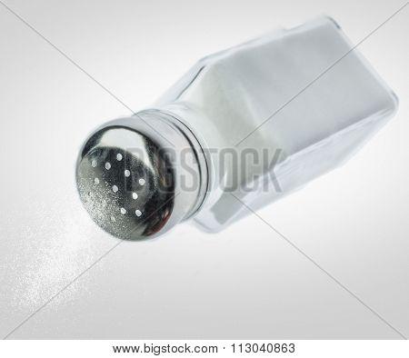 Pouring salt from a salt shaker