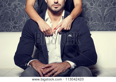 Woman hands undress man shirt from behind vintage style poster