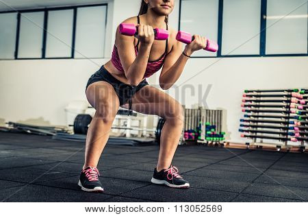Woman Doing Suats In A Fitness Center