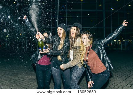 Girls Partying And Uncorking Champagne Bottle